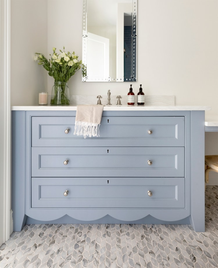 This stunning bathroom design by Bria Hammel Interiors is SO gorgeous - check out the scallop detailing on the vanity! #ABlissfulNest