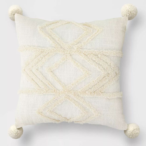 This textured throw pillow is a perfect neutral throw to add to your patio this spring! #ABlissfulNest