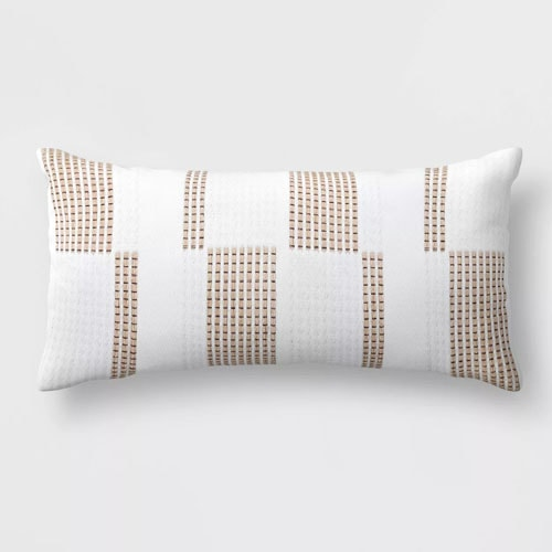 This woven lumbar pillow is such a fun, neutral piece to add to your patio this spring! #ABlissfulNest