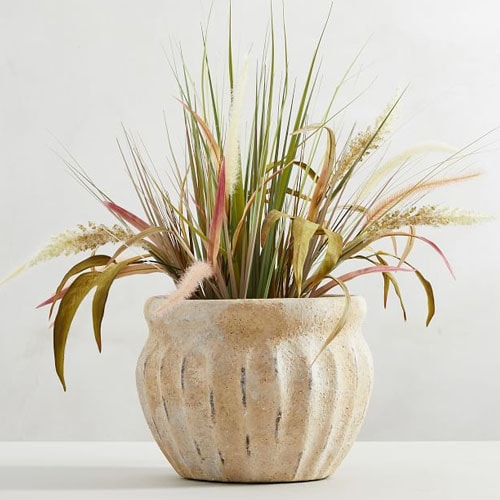 This weathered terra cotta planter is so pretty for your porch or patio this season! #ABlissfulNest