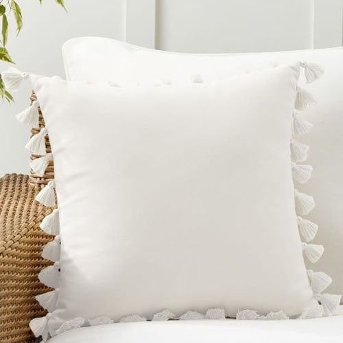 This white tassel trim throw pillow is a perfect, neutral addition to your outdoor setup this season! #ABlissfulNest