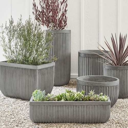 These concrete planters are so perfect for your outdoor living space! #ABlissfulNest