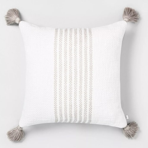 This white striped tassel throw pillow is such a beautiful addition to your home decor this spring! #ABlissfulNest