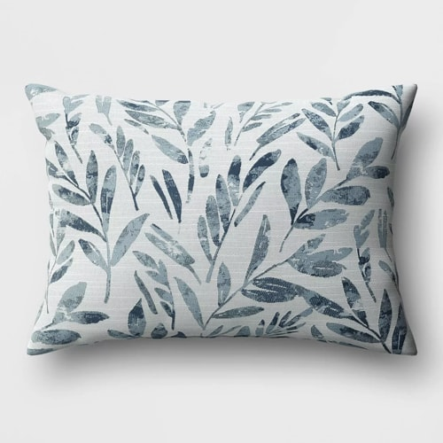 This blue floral throw pillow is an absolute must have this spring! #ABlissfulNest