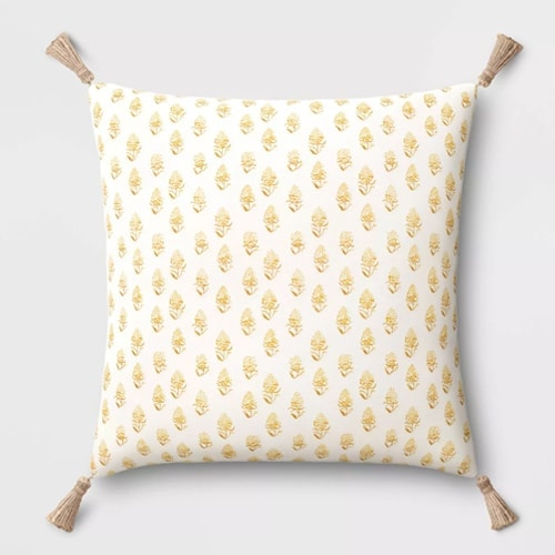 This yellow printed throw pillow adds the perfect pop of color to your spring decor! #ABlissfulNest