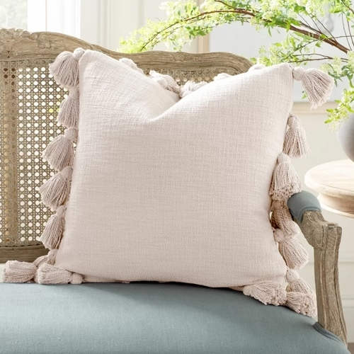 This tassel throw pillow is so pretty and neutral! #ABlissfulNest