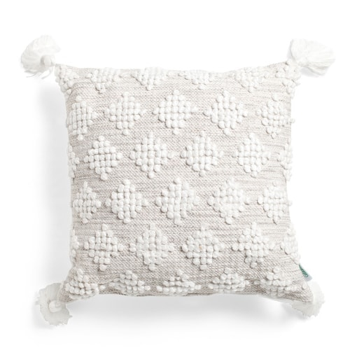 This white textured tassel throw pillow is a must-have for spring and summer! #ABlissfulNest
