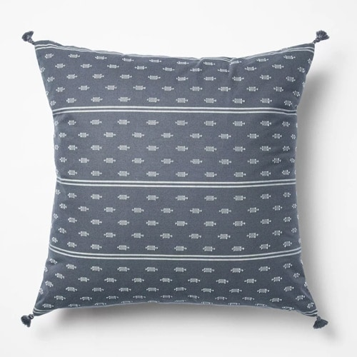 This blue woven throw pillow is under $25 and so pretty for spring! #ABlissfulNest