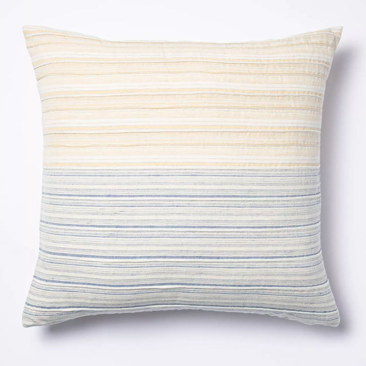 This yellow and blue striped throw pillow is a perfect addition to your lineup this spring! #ABlissfulNest