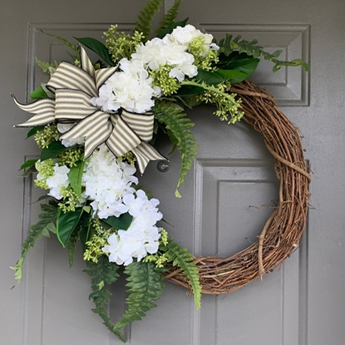 This white hydrangea wreath is a stunning addition to your front door this summer! #ABlissfulNest