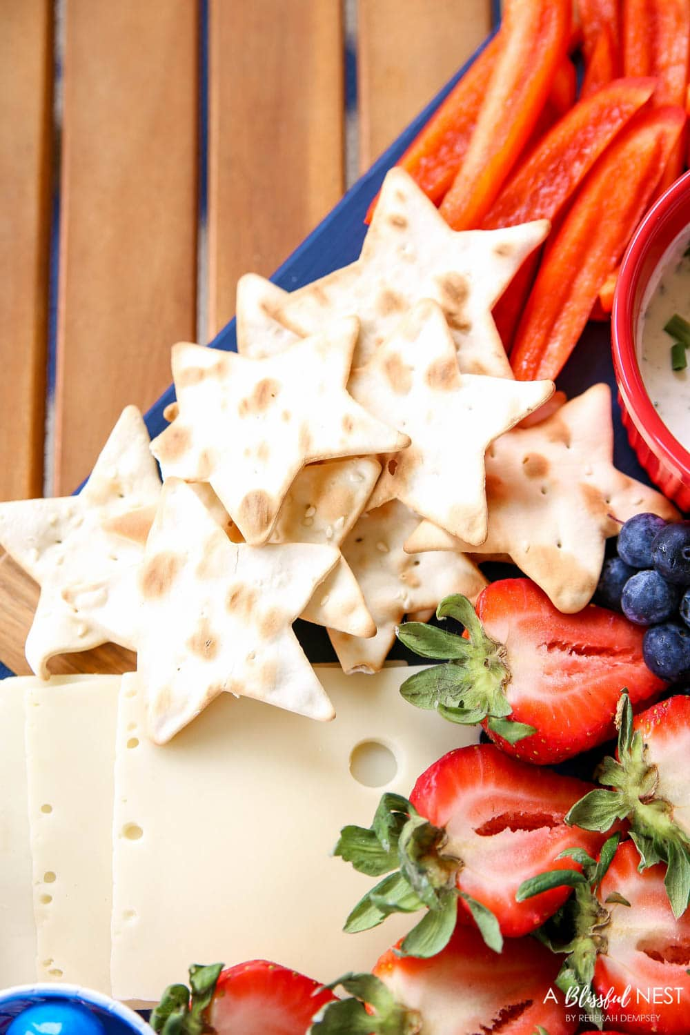 A beautiful patriotic charcuterie board with something for everyone. #ABlissfulNest #charcuterieboard #4thofjuly
