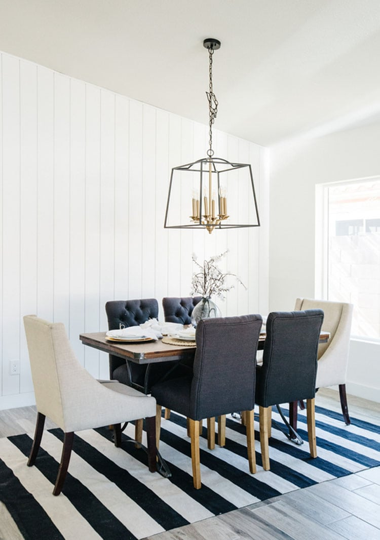 This gorgeous, bright dining room designed by Blissful Design Studio has the most perfect pops of bold color!