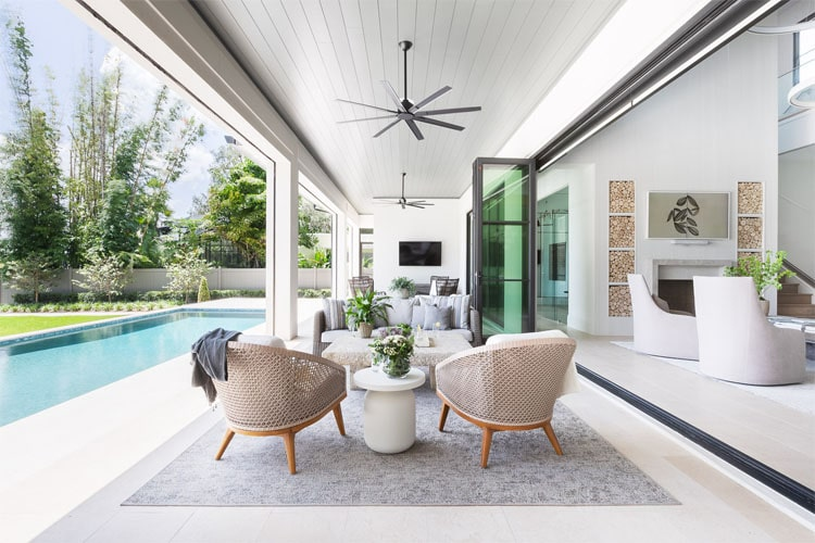 This beautiful indoor to outdoor living space designed by Brianna Michelle Design is such a gorgeous setup for summer!