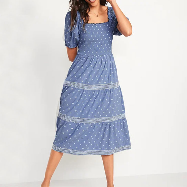 This puff-sleeve smocked embroidered dress is such a fun summer dress! #ABlissfulNest