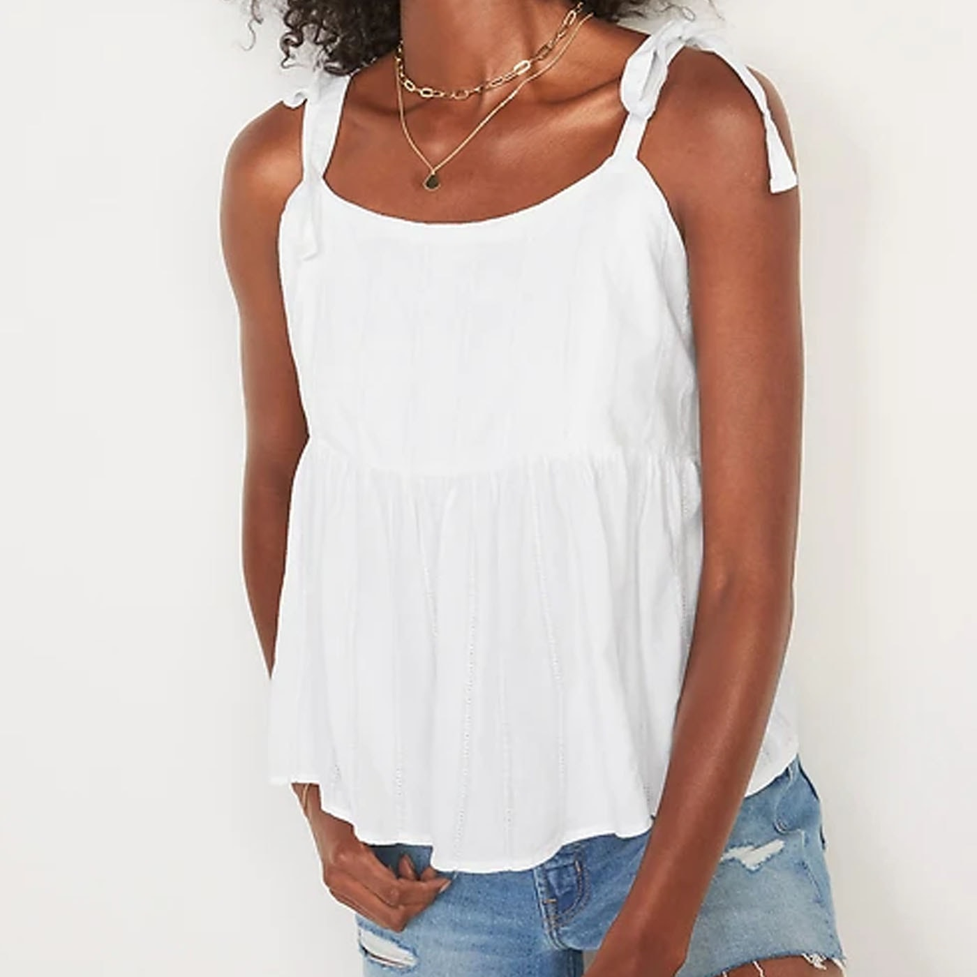 This white babydoll tank top is under $30 and perfect for summer! #ABlissfulNest