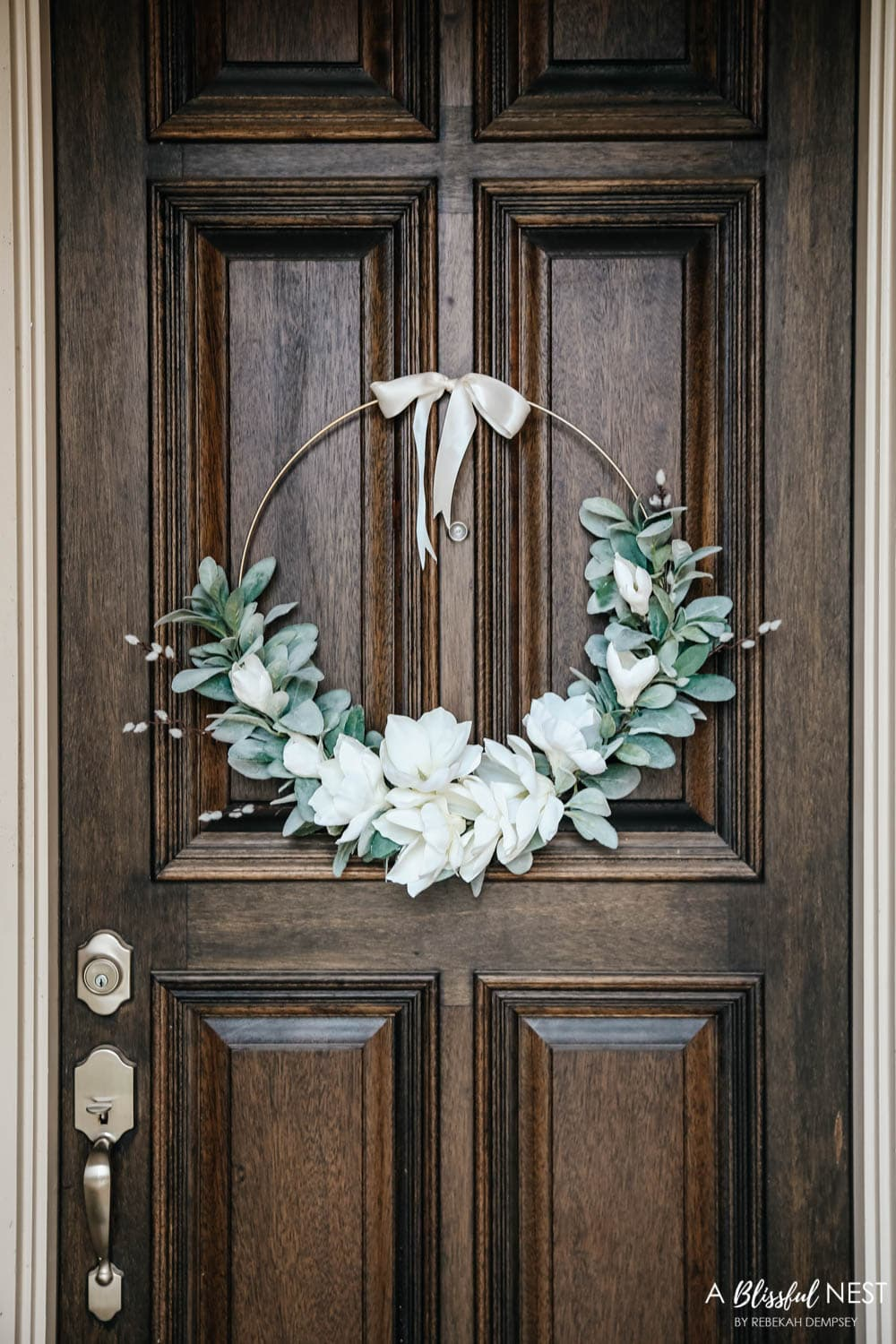 A simple fresh summer porch includes this beautiful hoop wreath, UV protected outdoor faux flowers, lanterns and more. #ABlissfulNest #summerporch #summerdecor