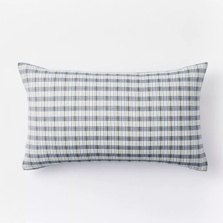 This blue plaid throw pillow would be so beautiful paired with a white and floral pillow in your living room this summer! #ABlissfulNest