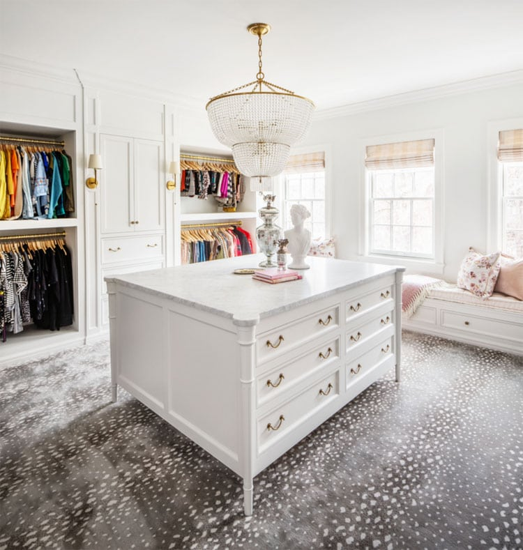 This gorgeous, bright and bold walk-in closet designed by The Fox Group is such a beautiful space!