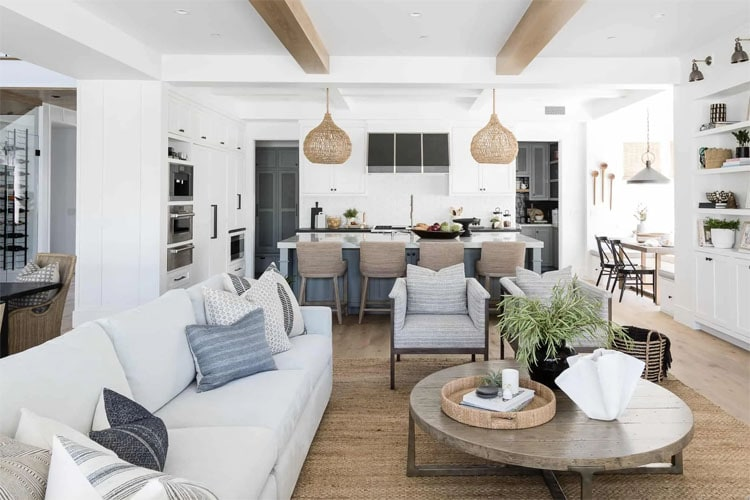 This gorgeous open concept kitchen and living area designed by Mindy Gayer Design is so pretty!