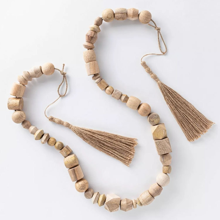 This decorative wooden bead garland is a perfect piece of decor to add into your home! #ABlissfulNest