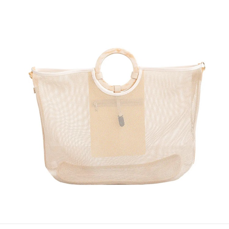 This mesh beach tote is perfect for your next trip to the beach! #ABlissfulNest