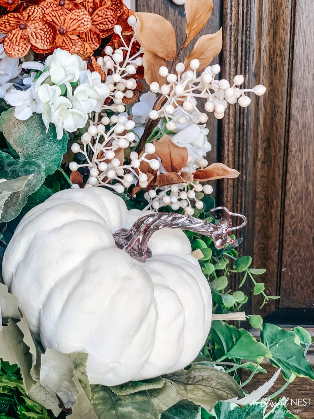 A small fall porch makeover with affordable finds from pumpkins, lanterns, fall wreath, and more. #ABlissfulNest #HobbyLobby #HobbyLobbyFinds #ad #fallporch #falldecor