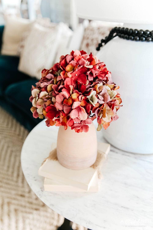 Add fall faux florals to the space. #ABlissfulNest #falldecor #fallideas