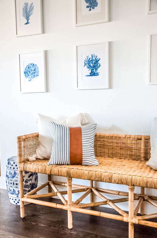 This leather and blue and white striped pillow is the easiest pillow to transition into any decor. #ShopABlissfulNest #pillowstyle #designtips