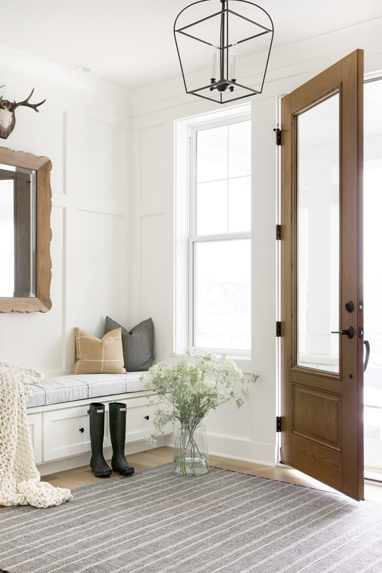 This gorgeous entryway designed by Bria Hammel Interiors is SO pretty!