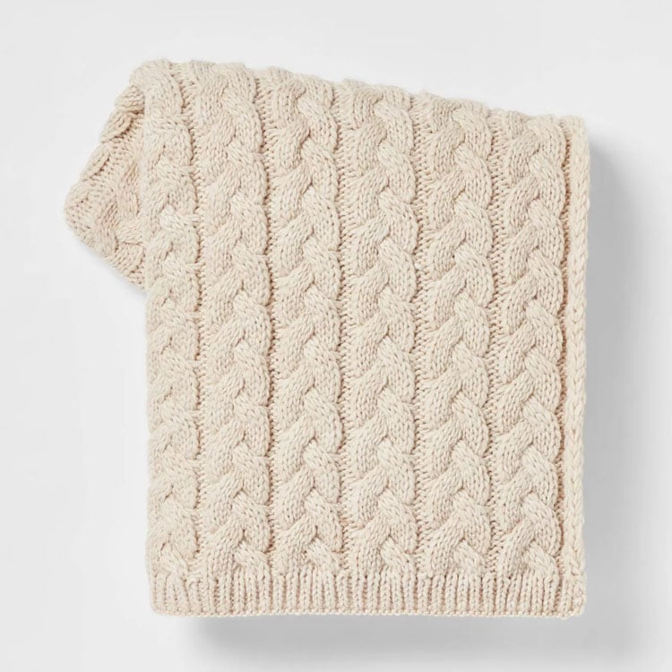 This cable knit throw blanket is affordable, comes in so many colors and is a must have for fall! #ABlissfulNest