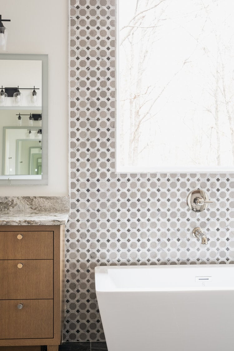 This gorgeous tiled bathroom designed by Adams Kirby Homes is so beautiful!