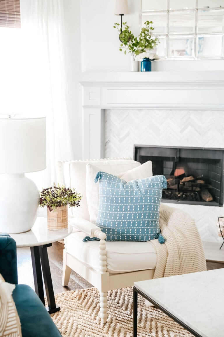 Shop our beautiful new pillow with white stitching to create that coastal decor style in your home. #ShopABlissfulNest #livingroomdecor #pillow #blueandwhite