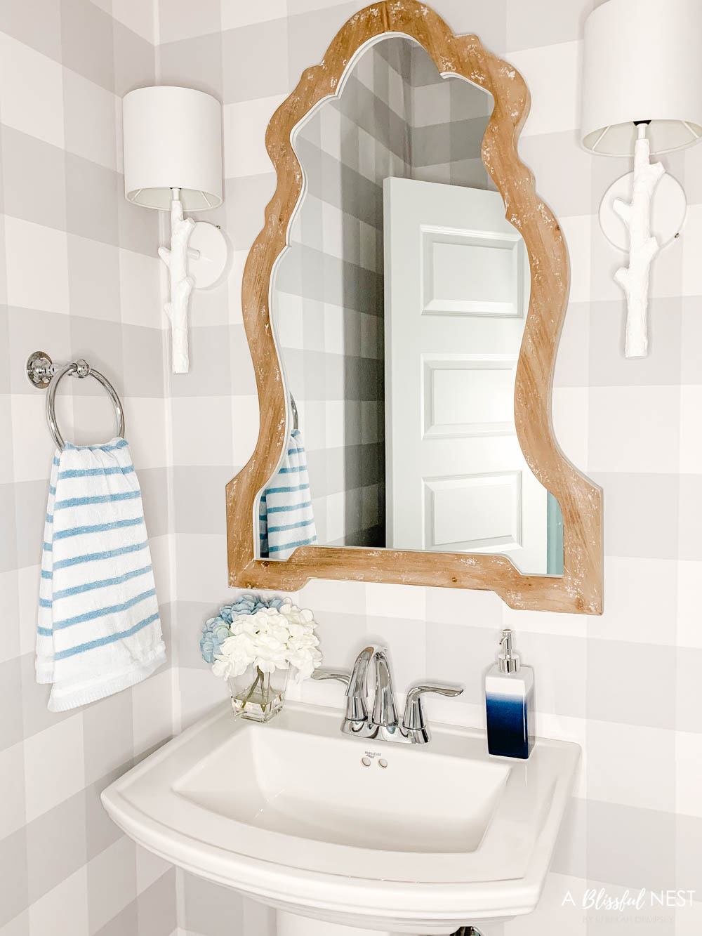 Soft blue decor accents, bathroom accessory updates, fresh candle, buffalo check wallpaper. #ABlissfulNest #WalmartHome #bathroomdesign