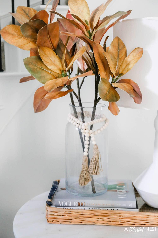 Amber colored faux magnolia leaves, fall florals, fall decor. #ABlissfulNest #falldecor