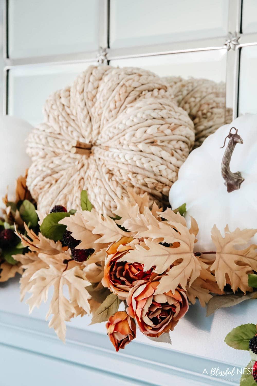 Cozy pillows, plush blankets, fall florals, fall decor. #ABlissfulNest #falldecor #falllivingroom