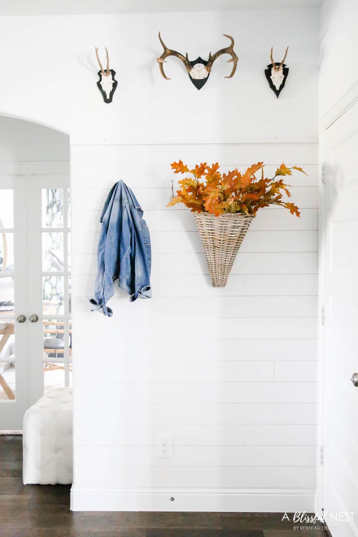 Basket with fall leaves, shiplap wall, mudroom, drop zone details. #ABlissfulNest #falldecor #fallideas